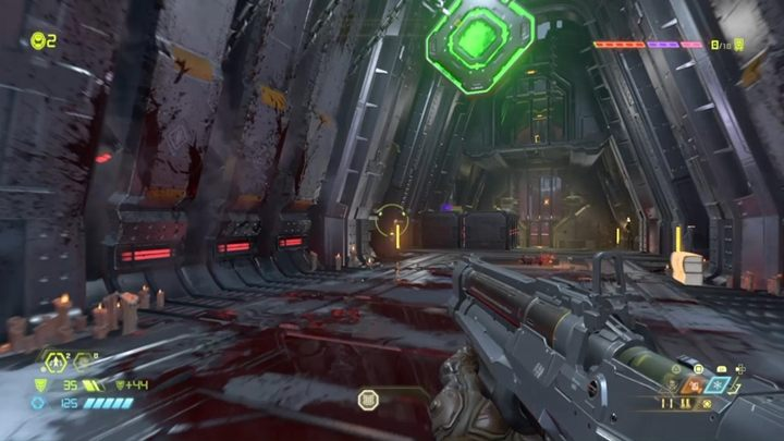 Sie befinden sich in einem Raum mit einem Monster und einem hängenden grünen Knopf - Doom Eternal: Komplettlösung für Kultisten - Walkthrough für Levels - Doom Eternal Guide