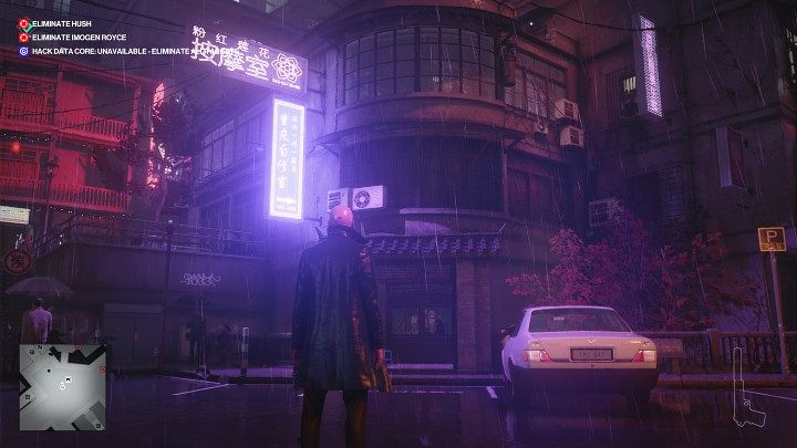 After starting the game, walk ahead and then take the stairs to the street level and enter the building shown in the image above - Hitman 3: Imogen Royce - how to kill her? Chongqing, China, walkthrough guide - End Of An Era - Chongqing - Hitman 3 Guide