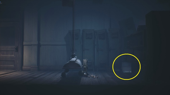 Moving on, you have to squeeze under the lamp and then crawl into the hole between the cabinets - Little Nightmares 2: School - guide, walkthrough description - Chapter 2 - Orphanage - Little Nightmares 2 Guide