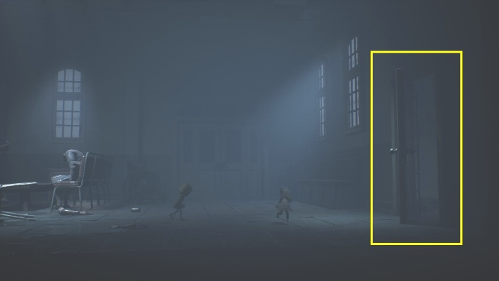 All you need to do to get out of the hospital is to reach the door, which turns out to be unlocked, allowing you to go through and continue onwards - Little Nightmares 2: Crossing the city - a guide, walkthrough - Chapter 4 - Getting to the Tower - Little Nightmares 2 Guide