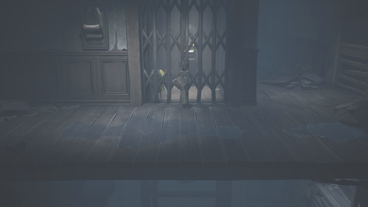 Head back to Six and release her from the elevator - Little Nightmares 2: Crossing the city - a guide, walkthrough - Chapter 4 - Getting to the Tower - Little Nightmares 2 Guide